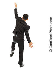 young business man climbing a wall with white background