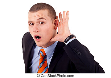 man cupping hand behind ear - Young business man cupping...