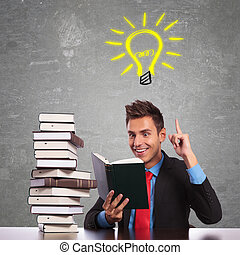 business man having a great idea while reading