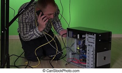 business man having computer problem and calling for help with mobile phone