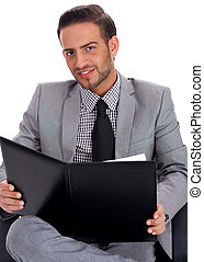 Young business man holding a clip board