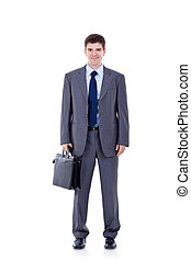 young business man holding briefcase - Full length portrait...
