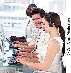 Man in Call centre looking and smiling at camera