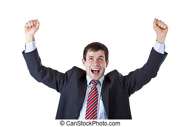 Young business man jubilates happy with clenched fists in the air. Freigestellt auf wei?em Hintergrund.
