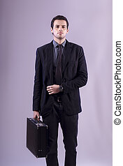 young business man on grey