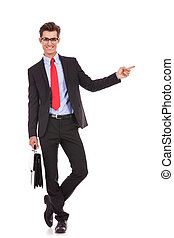 young business man  pointing his finger to his left side
