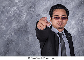 young business man pointing
