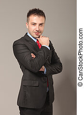 young business man posing with his arms crossed