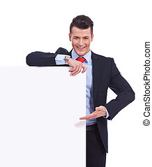 Young business man presenting a  blank board