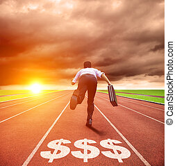 young business man running on track with money sign