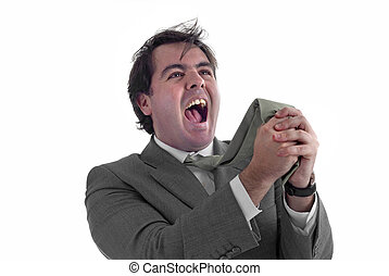 screaming - young business man screaming and pulling his tie