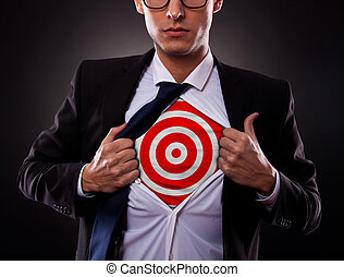 business man showing a target under his shirt - Young ...