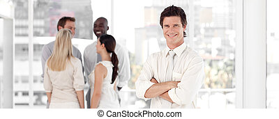 Young Business man Smiling in Front of Business team
