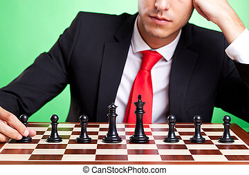 business man standing in front of chess line-up