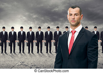 Young business man standing in front of his team