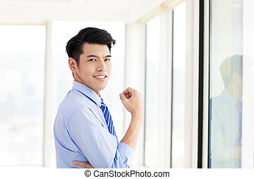 young Business man standing  in office