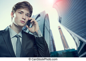 Young business man talking on cell phone