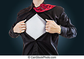 Young business man tearing apart his shirt revealing a...