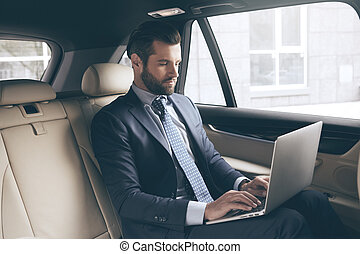 Young business man test drive new car - Young business...