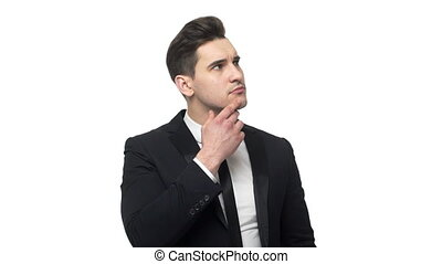 Young business man thoughtful thinking about project or idea isolated over white background.