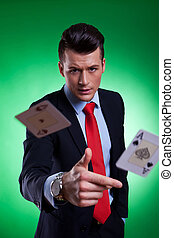 young business man throwing the winning hand