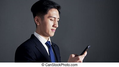 young business man using the smart phone