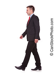 young business man walking