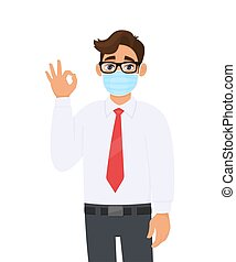 Young business man wearing face medical mask and showing ...