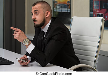 Young Business Man With A Finger Pointe