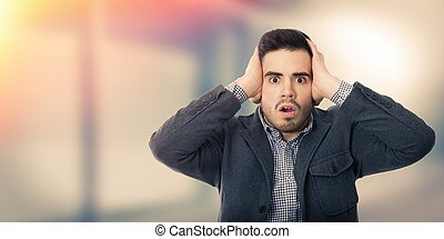 young business man with expression of surprise