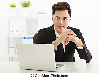 Young business man working in the  office