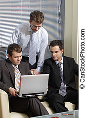 Young business men working with latop in office 1