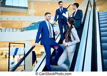 Young Business People at Escalator