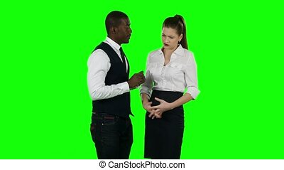 Young business people cooperate and shake hands. Green screen