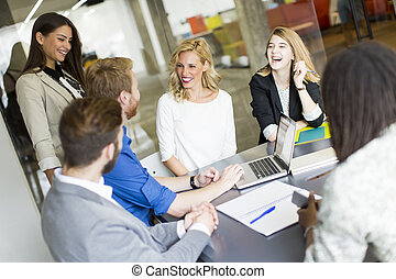 Young business people in modern office