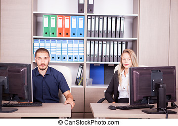 Young business people in office in front of their computers