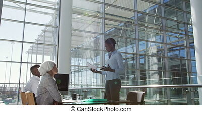 Young business people meeting in a modern office