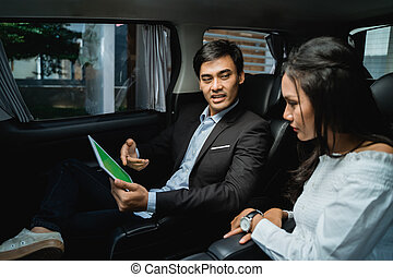 young business people meeting in the car