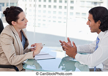 Young business people negotiating in a meeting room