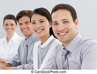 Young business people sitting in a line
