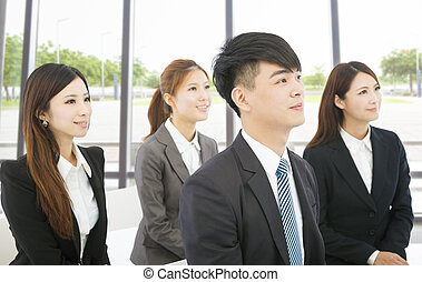 young business people sitting together in the office