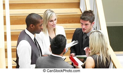 Young business people talking in corridor footage in High Definition
