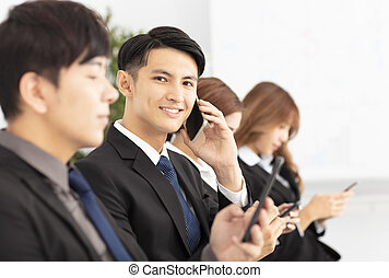 young business people using and talking the smart phone