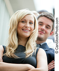 Young business people with arms crossed