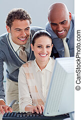 Young business people working at a computer
