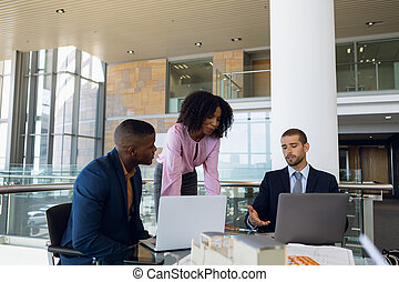 Young business people working in modern office