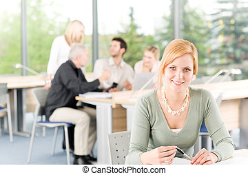 Young business students - businesswoman in front