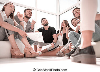 young business team sitting in new office
