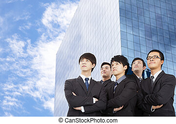 young business team standing before the modern building