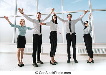 young business team standing in an empty new office.